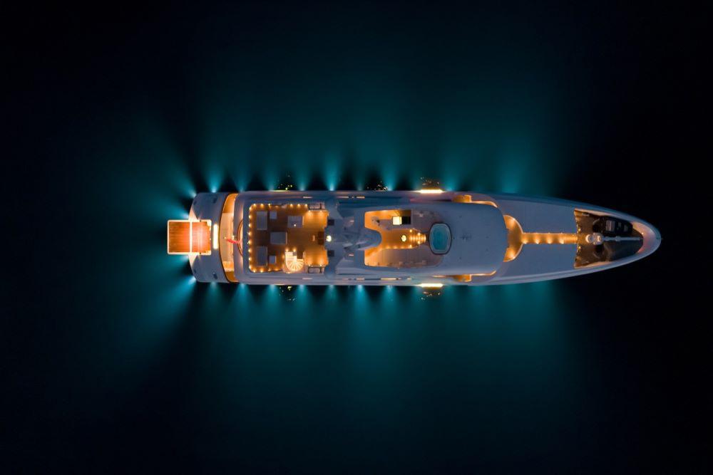 Superyacht illuminated at night